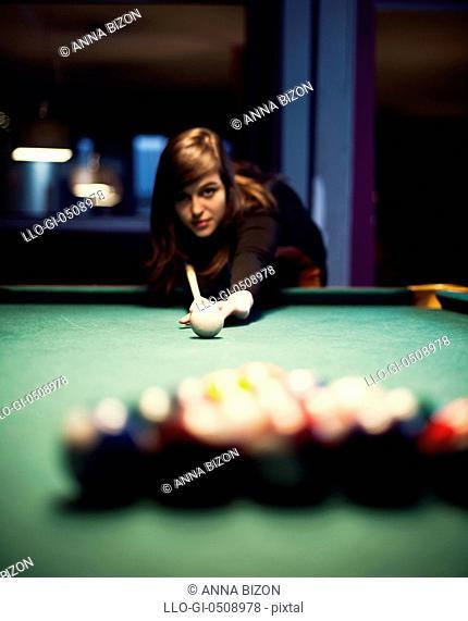 Young woman playing billiard Debica, Poland