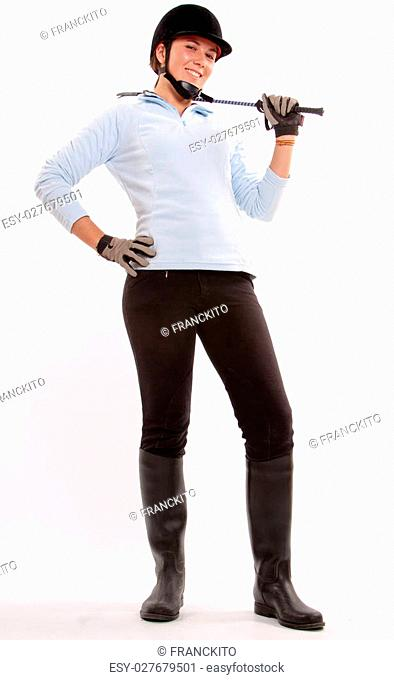 Isolated image of a teenage girl dressed in horse riding clothes