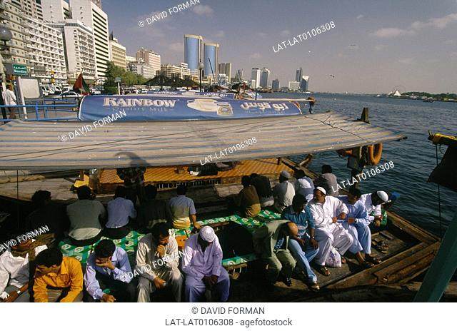 Water taxi full of passengers,people. Public transport