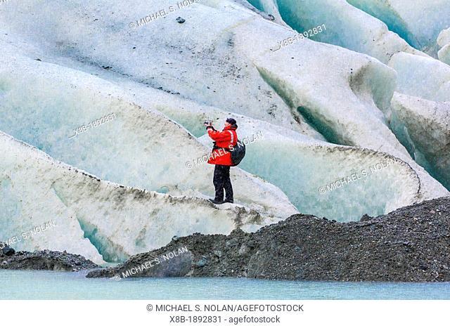 Photographer Ralph Lee Hopkins at the Bernal Glacier in Estero Las Montanas, Strait of Magellan, Patagonia, Chile