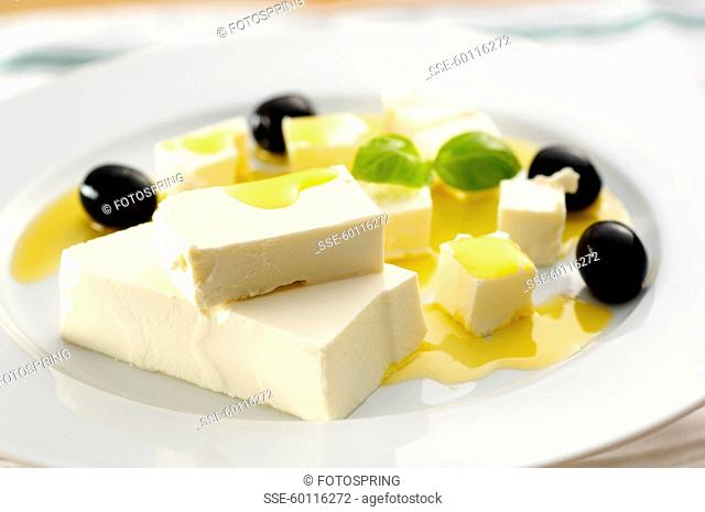 Feta cheese,virgin olive oil and black olives