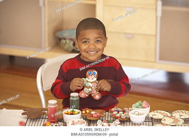 Young boy making gingerbread men