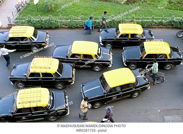 Yellow top and black body seven taxies in Bombay Mumbai , Maharashtra , India