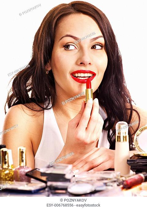 Girl applying makeup. Isolated