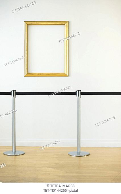 Blank picture frame in empty art gallery