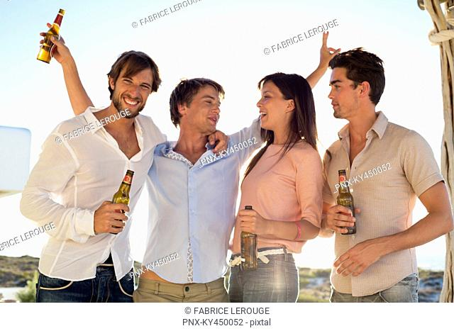 Four friends drinking beer