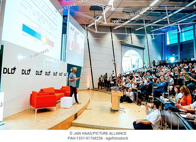 BAYREUTH/GERMANY - JUNE 21: Cyborg Neil Harbisson (Cyborg Org) with his antenna speaks on the stage during the DLD Campus event at the University of Bayreuth on...