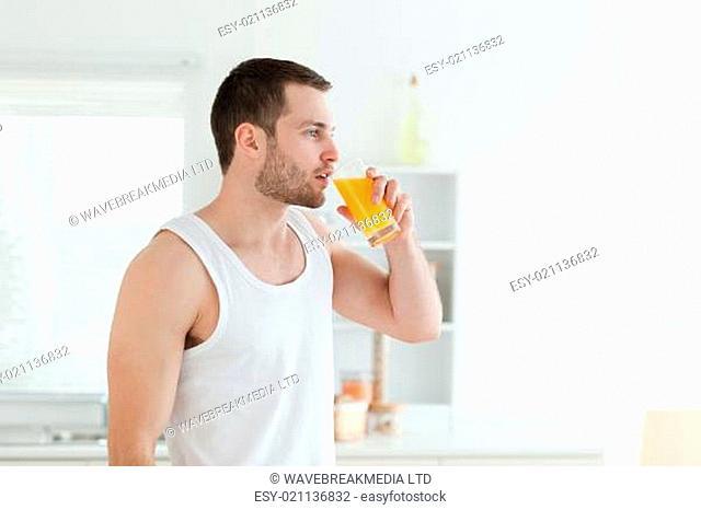 Quiet man drinking orange juice
