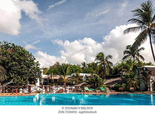 Swimming pool, palm trees and sky