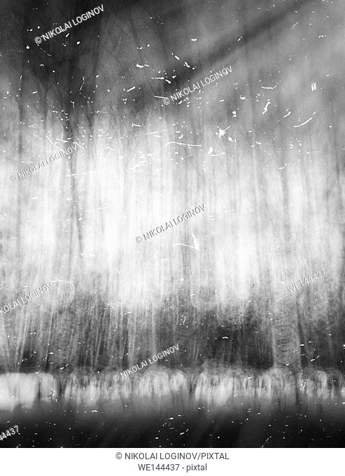 Vertical black and white abstract landscape with dust snow background