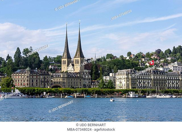View on the north bank with court chapel St. Leodegar and Hotel National, Lucerne, Lake Lucerne, Canton Lucerne, Switzerland