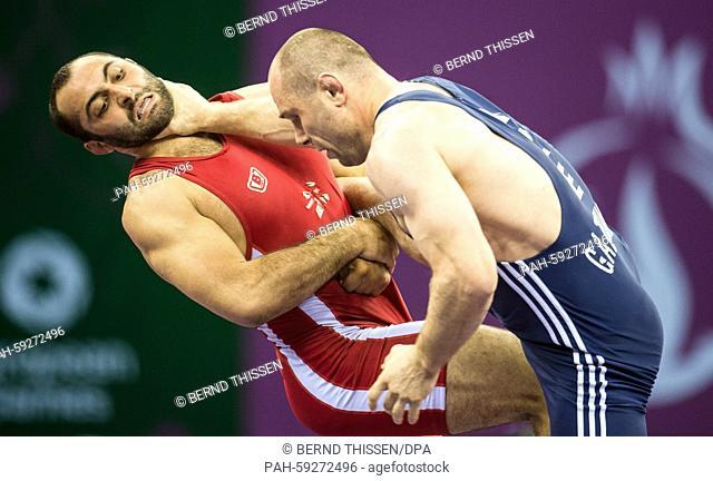Georgias Elizbar Odikadze (red) competes with Khetag Gazyumov of Asherbaijan (blue) in the wrestling Men's 97kg Freestyle Final at the Baku 2015 European Games...