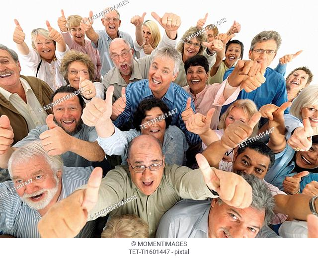 A group of people giving the thumbs up sign