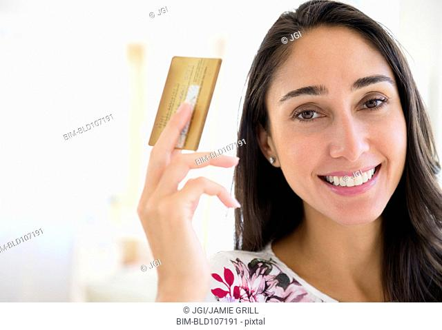 Caucasian woman holding credit card