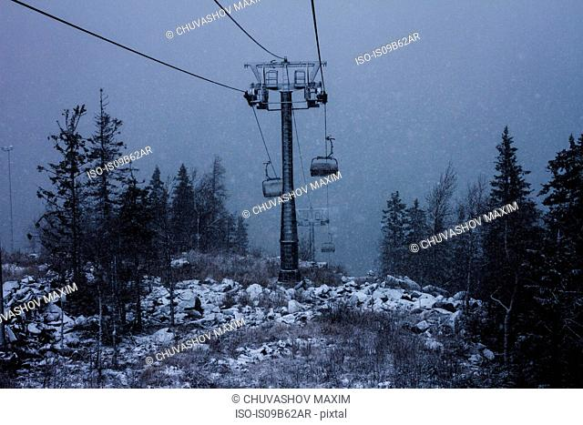 High angle view of chairlift during mountain snowstorm