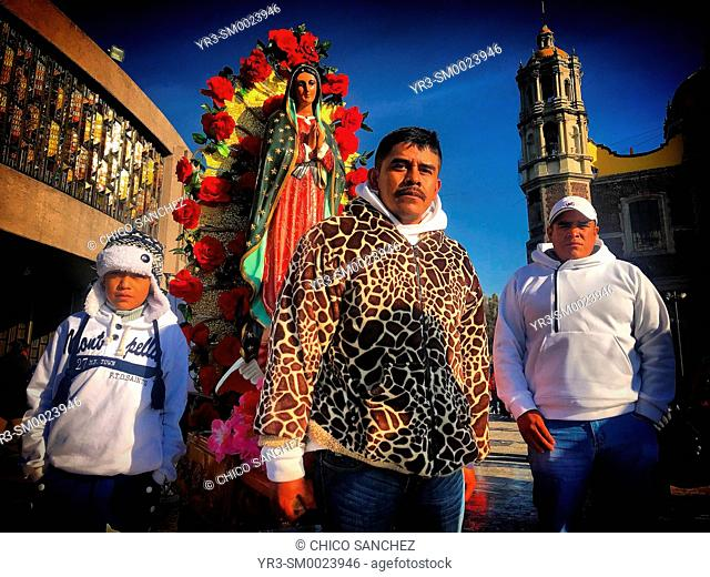 Pilgrims carry an image of Our Lady of Guadlaupe during the annual pilgrimage to the Our Lady of Guadalupe Basilica in Mexico City, Mexico