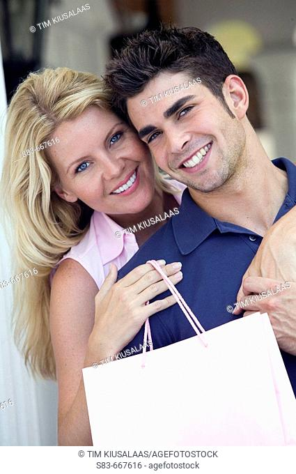 Young happy couple shopping