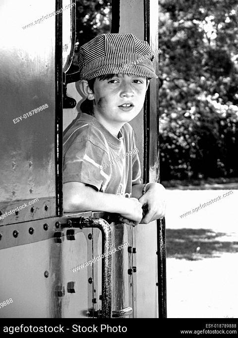 Junge auf Dampflok