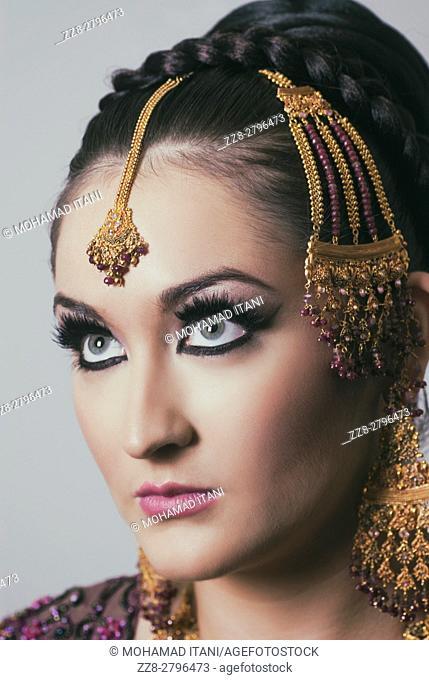Beautiful Asian bride looking up