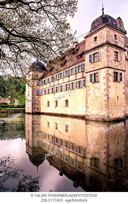 Castle Wasserschloss with pond around the wall in Mitzwitz, Germany