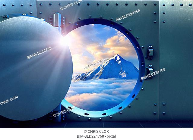 Open vault door revealing mountaintop above clouds