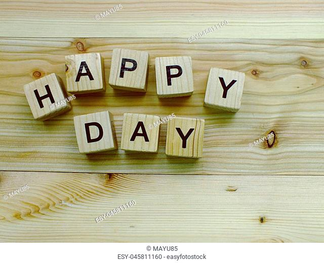 happy day wooden block with space copy background