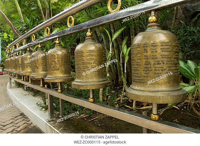 Thailand, Samut Sakhon, row of Buddhistic bells