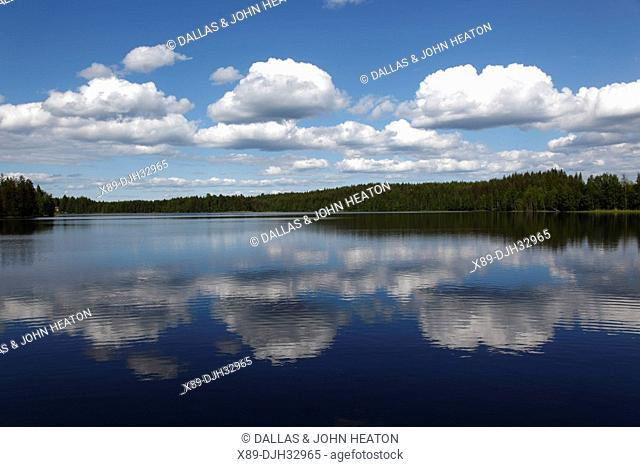 Finland, Region of Southern Savonia, Savonlinna, Saimaa Lake District, Clouds Reflected in Lake Puruvesi