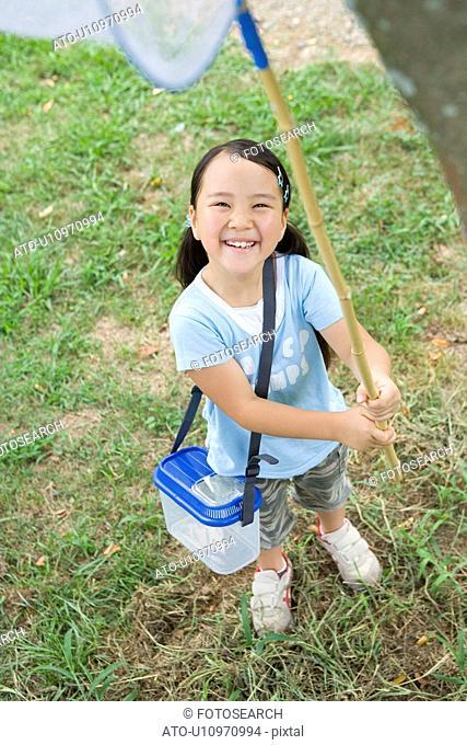 Girl with Butterfly Net in Field