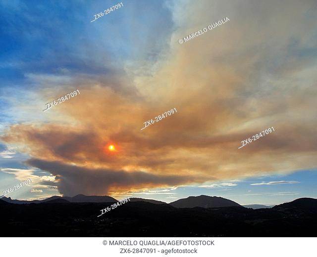 Forest fire cloud at Tieno region, seen from Villandás village at Grado Council, end of July 2015, produced by climate change alterations in temperature and...