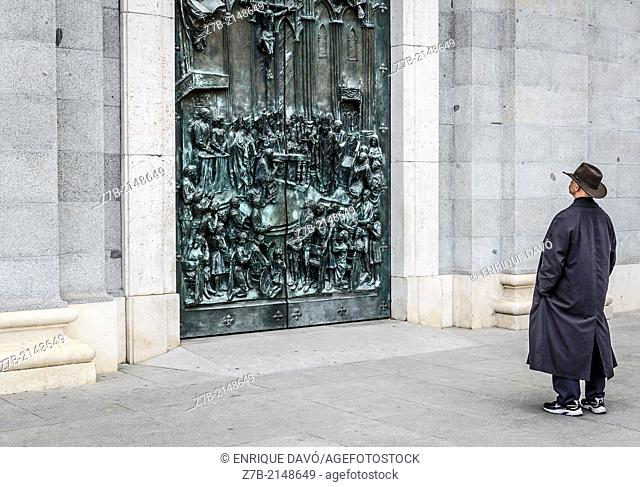 View of a man with a brown hat in the entrance of Almudena Cathedral, Madrid city, Spain