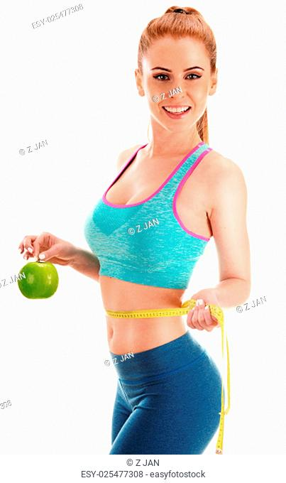 Young woman holding measure tape and apple. Weight loss