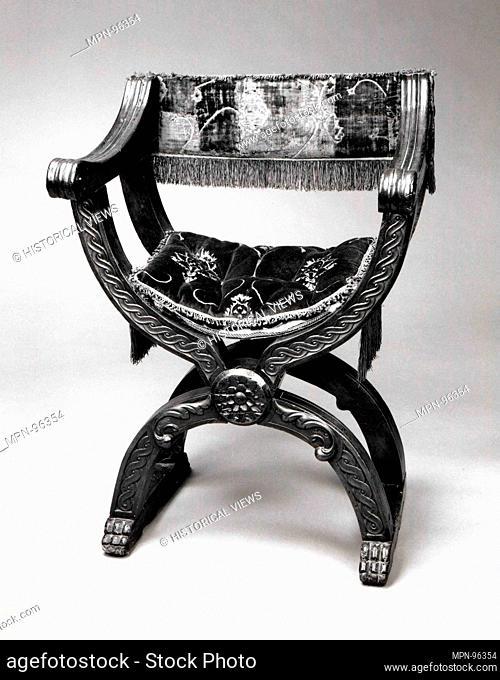 Hip-joint armchair (Dantesca type, associated with 1975.1.1975 a,b). Date: 15th or 16th century (textiles); 20th century (cushion); Culture: Italian; Medium:...