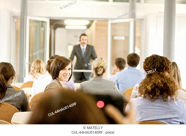 Business people sitting in seminar