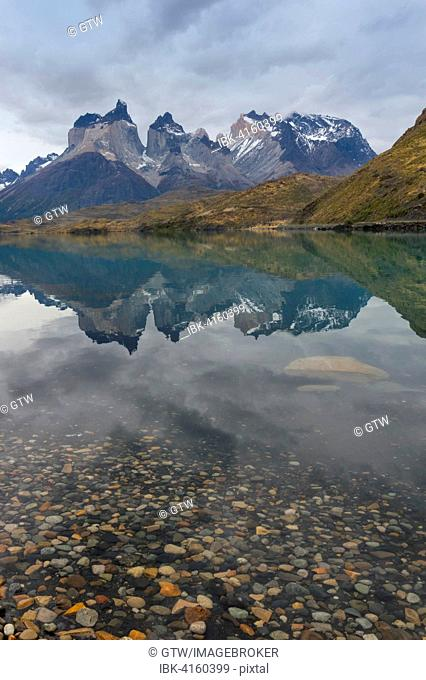 Cuernos del Paine reflecting in Lago Pehoe, Torres del Paine National Park, Chilean Patagonia, Chile