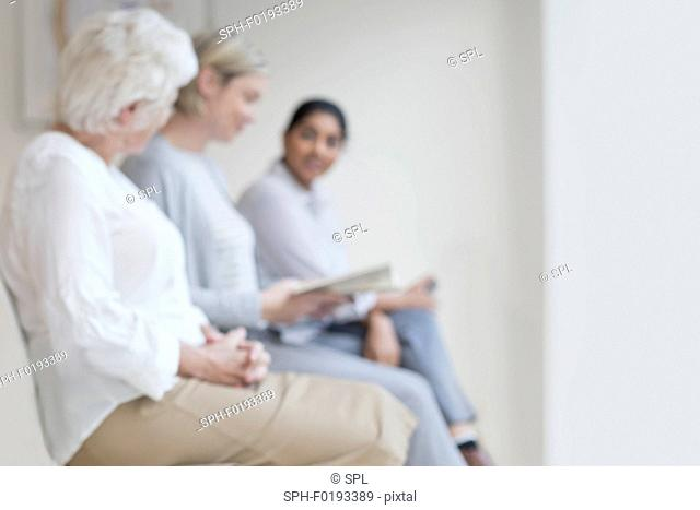 Women sitting in doctor's waiting room