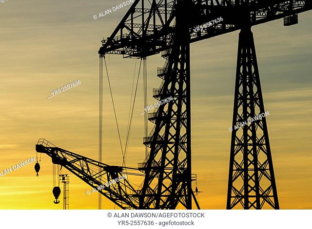 Tees Transporter bridge silhouetted against setting sun, Middlesbrough, north east England, United Kingdom. The Tees Transporter Bridge is one of only three...