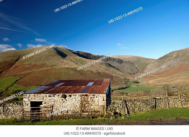 Late autumn on Cautley Crag in the Howgills, seen from Bluecaster, Sedbergh, Cumbria, UK. (Photo by: Wayne Hutchinson/Farm Images/UIG)