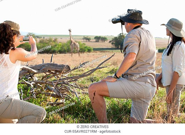 People photographing wildlife on safari, Stellenbosch, South Africa