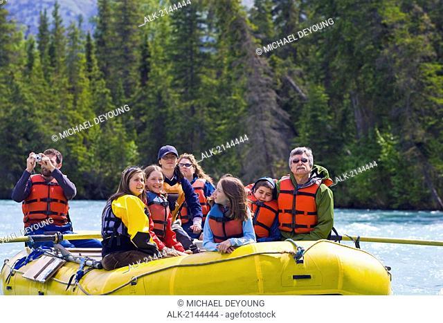 Large Family Rafting On The Kenai River Near Cooper Landing On The Kenai Peninsula During Summer In Alaska