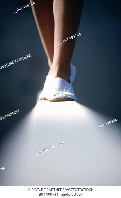 Woman's artistic gymnastics. Balance beam
