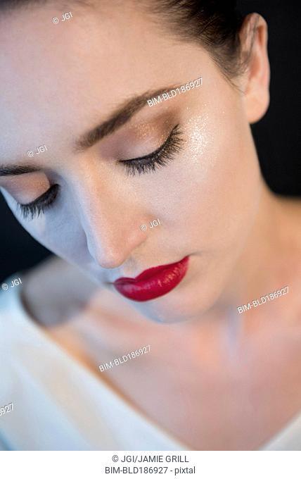 Caucasian woman wearing glamorous makeup