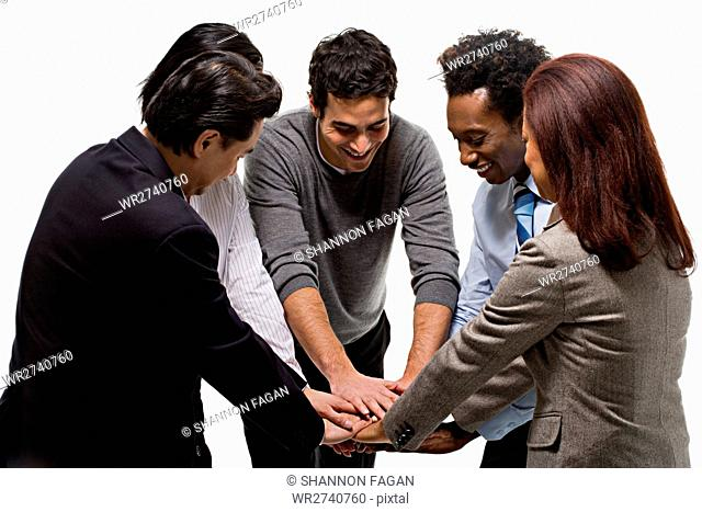five office workers showing unity
