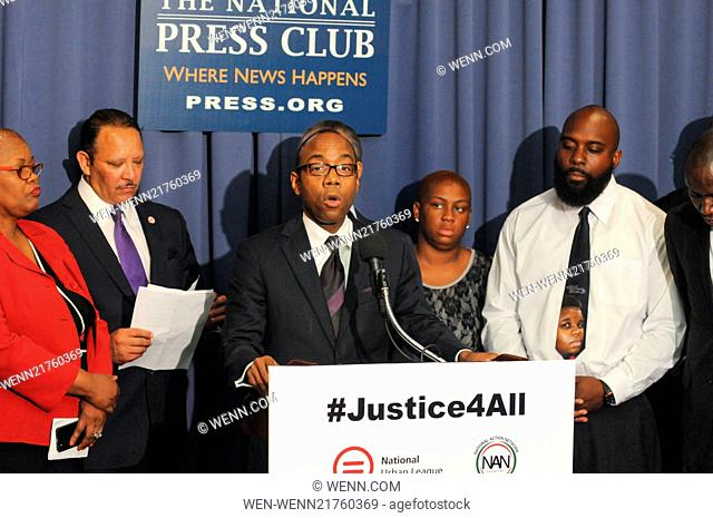 Civil rights leaders join the families of Michael Brown and Eric Garner at a press conference to call for immediate justice and federal review of racial...