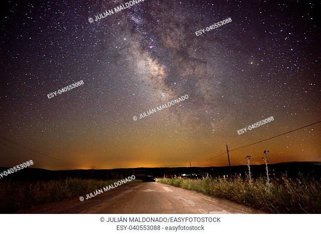Road landscape with Milky Way galaxy in the sky, Almagro, Ciudad Real, Spain