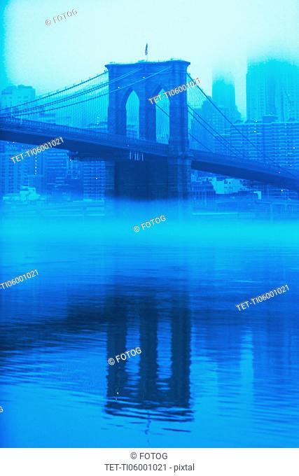 USA, New York, New York City, Manhattan, Brooklyn Bridge over East River in fog