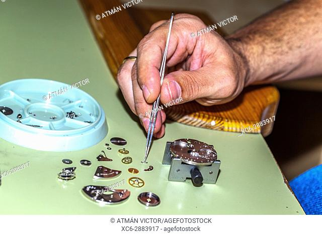 Watch repairer working with watch pieces
