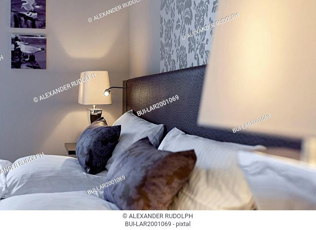 Pillows and bedside night lamp shades in bedroom
