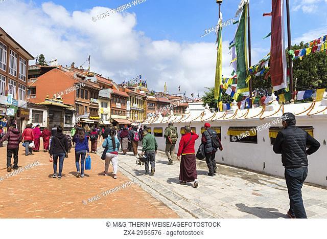Buddhist pilgrims making the kora or ritual circumnavigation around the Boudhanath Stupa, Largest Asian Stupa, Unesco World Heritage Site, Kathmandu, Nepal