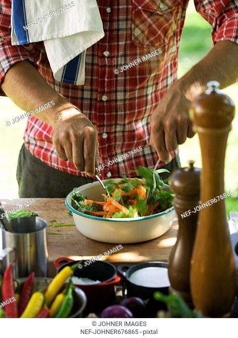 Man cooking outdoors, Sweden